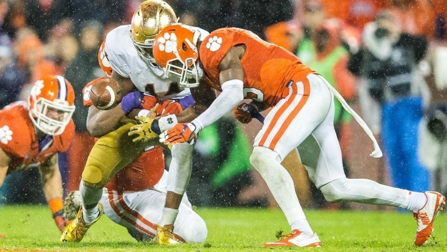 Oct 3, 2015; Clemson, SC, USA; Notre Dame Fighting Irish quarterback DeShone Kizer (14) fumbles as he is hit by Clemson Tigers safety T.J. Green (15) in the fourth quarter at Clemson Memorial Stadium. Clemson won 24-22. Mandatory Credit: Matt Cashore-USA TODAY Sports