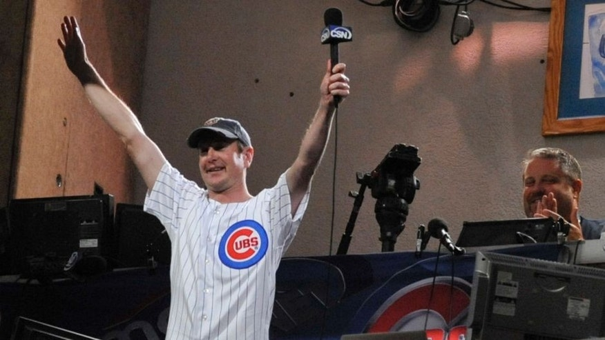 CHICAGO, IL - SEPTEMBER 19: NASCAR driver Kurt Busch sings take me out to the ball game during the Milwaukee Brewers Chicago Cubs game on September 19, 2011 at Wrigley Field in Chicago, Illinois. (Photo by David Banks/Getty Images)