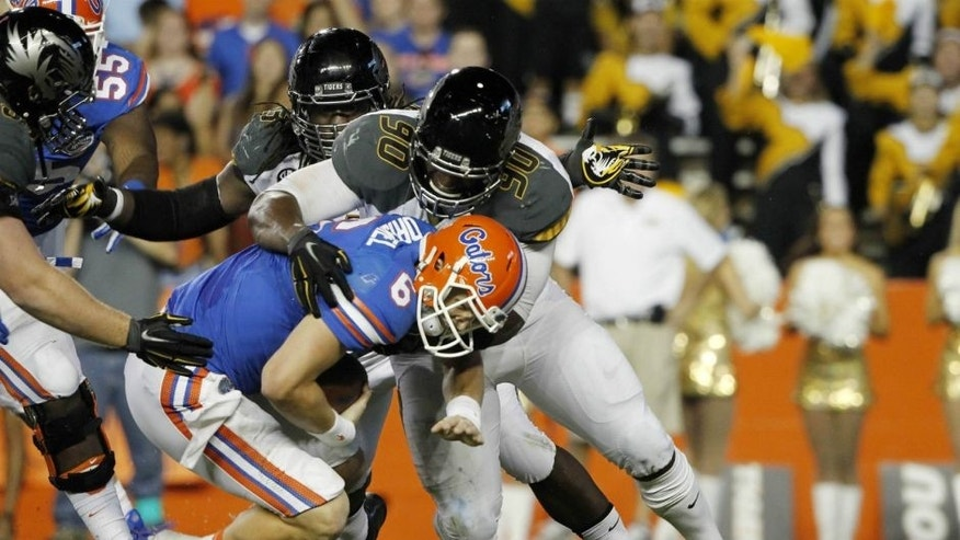 <p>Oct 18, 2014; Gainesville, FL, USA; Missouri Tigers defensive lineman Harold Brantley (90) sacks Florida Gators quarterback Jeff Driskel (6) during the first half at Ben Hill Griffin Stadium. Mandatory Credit: Kim Klement-USA TODAY Sports</p>