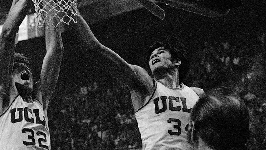 <p>In this Dec. 15, 1973, file photo, UCLA's Bill Walton and Dave Meyers (right) reach for a rebound.</p>