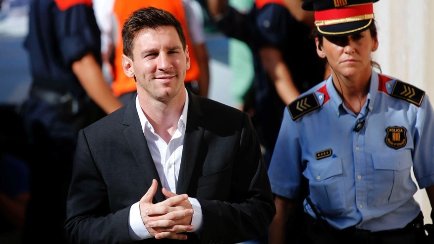 FILE - In this Sept. 27, 2013 file photo, FC Barcelona star Lionel Messi, left, arrives at a court to answer questions in a tax fraud case in Gava, near Barcelona, Spain.