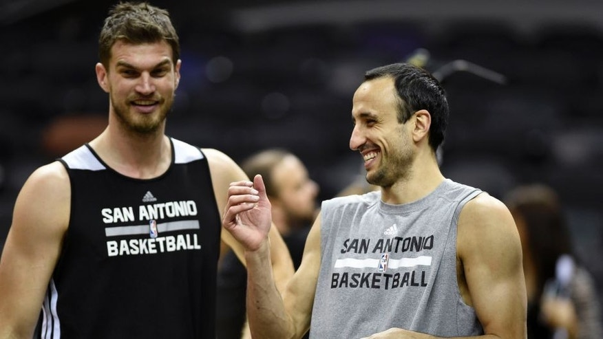 <p>Jun 4, 2014; San Antonio, TX, USA; San Antonio Spurs guard Manu Ginobili (20) laughs with San Antonio Spurs center Tiago Splitter (22) during practice before game one of the 2014 NBA Finals against the Miami Heat at the AT&T Center. Mandatory Credit: Bob Donnan-USA TODAY Sports</p>