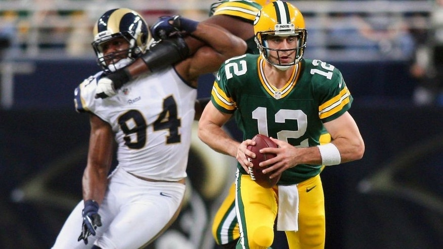 Oct 21, 2012; St. Louis, MO, USA; Green Bay Packers quarterback Aaron Rodgers (12) scrambles against the St. Louis Rams during the second half at Edward Jones Dome. The Packers defeated the Rams 30-20. Mandatory Credit: Scott Kane-USA TODAY Sports