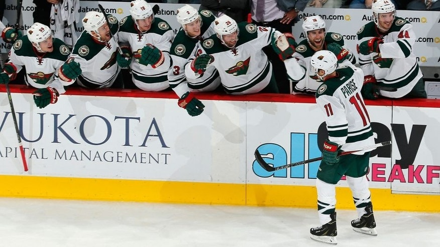 <p>Minnesota Wild left wing Zach Parise celebrates a hat trick goal with teammates on the bench during the third period of an NHL hockey game against the Colorado Avalanche, Thursday, Oct. 8, 2015, in Denver. Minnesota beat Colorado 5-4. (AP Photo/Jack Dempsey)</p>
