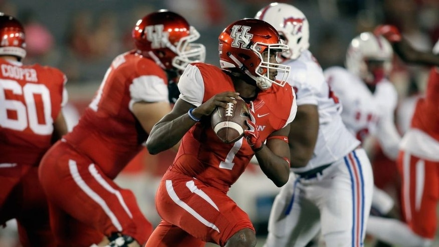 Oct 8, 2015; Houston, TX, USA; University of Houston Cougars quarterback Greg Ward Jr. (1) prepares to throw against the Southern Methodist University Mustangs in the first quarter at TDECU Stadium. Mandatory Credit: Erich Schlegel-USA TODAY Sports
