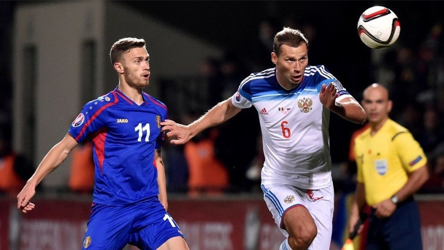 Russia's defender Aleksei Berezutski (R) vies Moldova's forward Nicolae Milinceanu during the Euro 2016 qualifying football match between Russia and Moldova at the Stadionul Zimbru in Chisinau on October 9, 2015. AFP PHOTO / KIRILL KUDRYAVTSEV (Photo credit should read KIRILL KUDRYAVTSEV/AFP/Getty Images)
