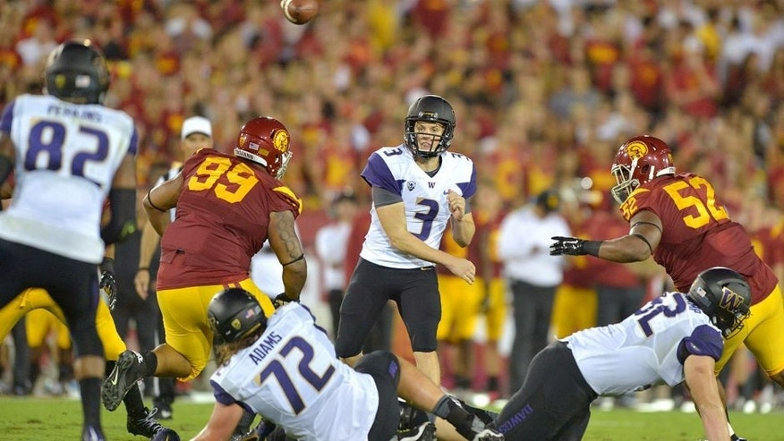 Oct 8, 2015; Los Angeles, CA, USA; Washington Huskies quarterback Jake Browning (3) throws a pass to tight end Joshua Perkins (82) against the Southern California Trojans at Los Angeles Memorial Coliseum. Mandatory Credit: Kirby Lee-USA TODAY Sports