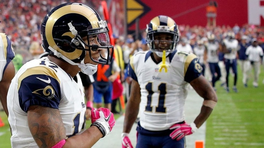 St. Louis Rams wide receiver Stedman Bailey (12) celebrates his touchdown receptions with teammates Kenny Britt (18) and Tavon Austin (11) during the second half of an NFL football game against the Arizona Cardinals, Sunday, Oct. 4, 2015, in Glendale, Ariz. (AP Photo/Ross D. Franklin)