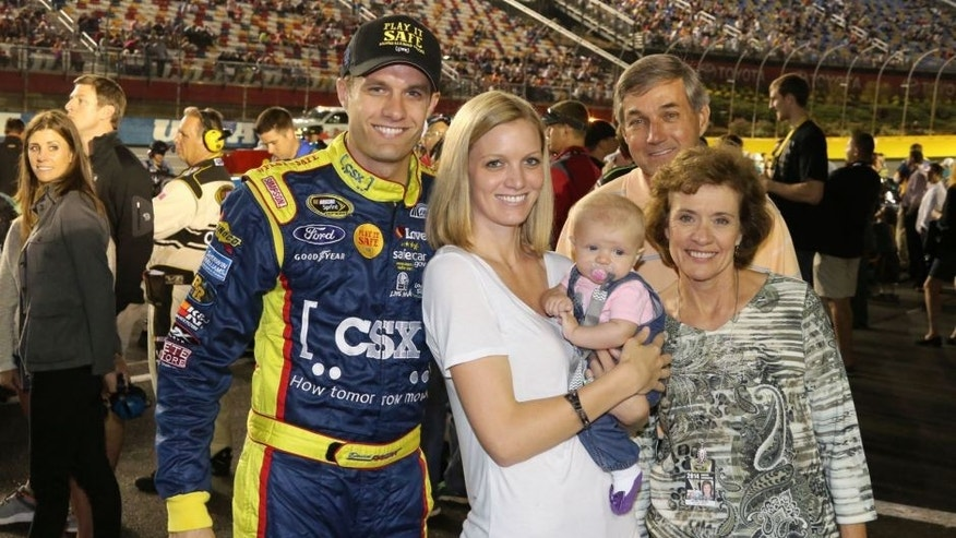 USA -Oct 11: David Ragan, driver of the #34 CSX - Play It Safe Ford Fusion, poses for a photo with his wife Jacquelyn and family prior to the start of the NASCAR Sprint Cup Series Bank of America 500 at the Charlotte Motor Speedway in Concord, NC. Picture taken on Oct 11, 2014 in the United States. (Photo by Jim Fluharty/NASCAR Illustrated/Sporting News via Getty Images)