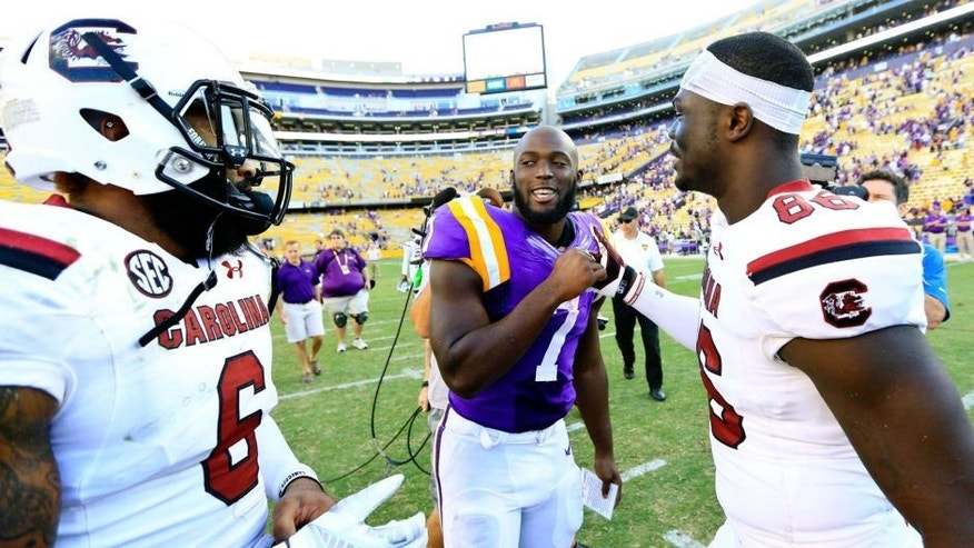 Oct 10, 2015; Baton Rouge, LA, USA; LSU Tigers running back Leonard Fournette (7) talks to South Carolina Gamecocks tight end Kevin Crosby (86) and safety Chris Moody (6) following road game at Tiger Stadium. LSU defeated South Carolina 45-24. Mandatory Credit: Derick E. Hingle-USA TODAY Sports
