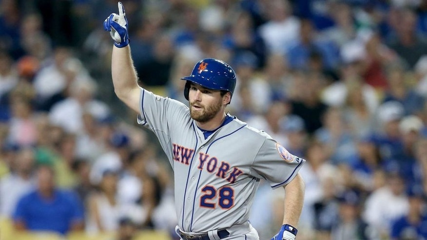 LOS ANGELES, CA - OCTOBER 09: Daniel Murphy #28 of the New York Mets reacts after he hits a solo home run in the fourth inning against the Los Angeles Dodgers in game one of the National League Division Series at Dodger Stadium on October 9, 2015 in Los Angeles, California. (Photo by Stephen Dunn/Getty Images)