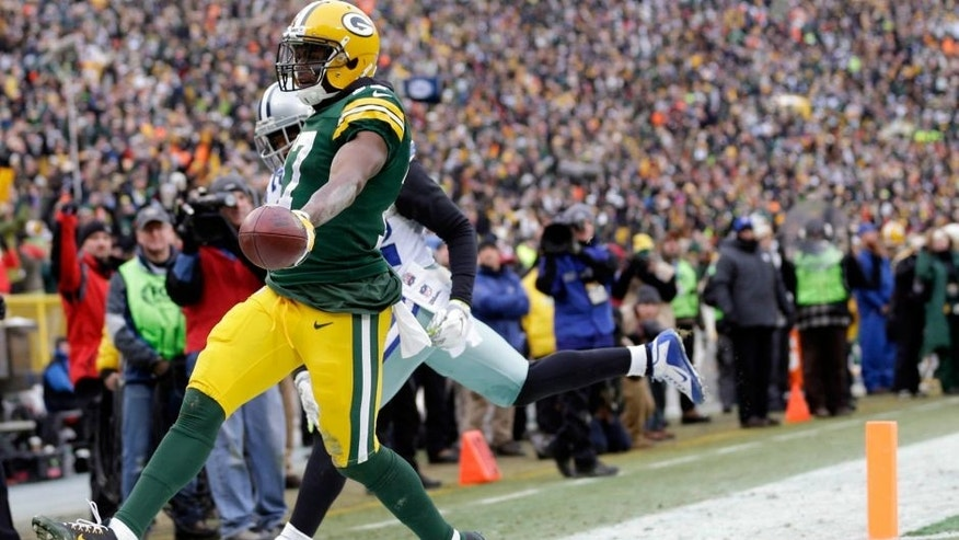 <p>Jan 11, 2015; Green Bay, WI, USA; Green Bay Packers wide receiver Davante Adams (17) scores a touchdown against the Dallas Cowboys in the third quarter in the 2014 NFC Divisional playoff football game at Lambeau Field. Mandatory Credit: Jeff Hanisch-USA TODAY Sports</p>