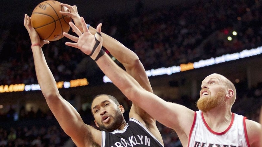 Nov 15, 2014; Portland, OR, USA; Brooklyn Nets center Jerome Jordan (9) and Portland Trail Blazers center Chris Kaman (35) go up for a rebound at Moda Center at the Rose Quarter. Mandatory Credit: Jaime Valdez-USA TODAY Sports