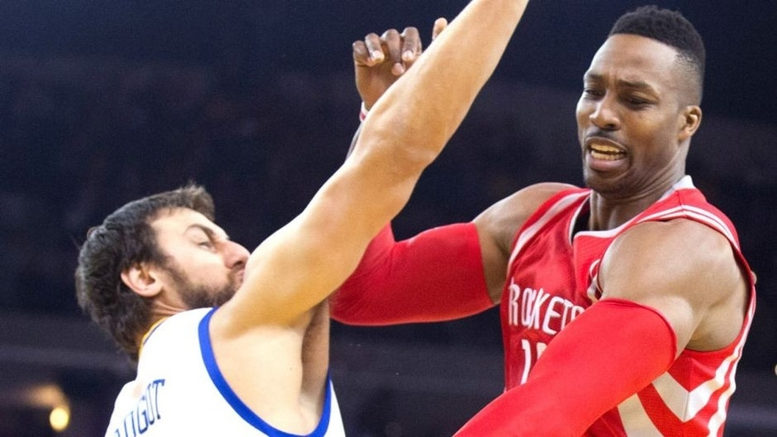 Jan 21, 2015; Oakland, CA, USA; Houston Rockets center Dwight Howard (12) controls the ball against Golden State Warriors center Andrew Bogut (12) during the first quarter at Oracle Arena. Mandatory Credit: Kelley L Cox-USA TODAY Sports