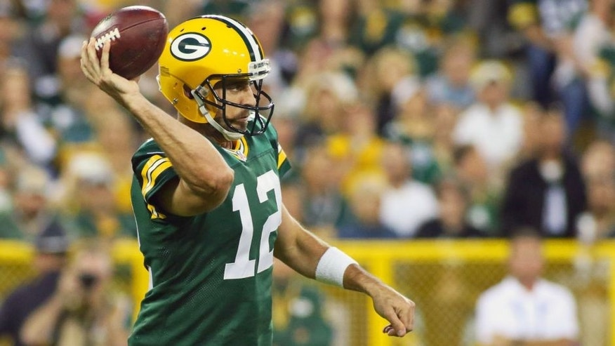 Sep 20, 2015; Green Bay, WI, USA; Green Bay Packers quarterback Aaron Rodgers (12) passes against the Seattle Seahawks during the first quarter at Lambeau Field. Packers won 27-17. Mandatory Credit: Ray Carlin-USA TODAY Sports