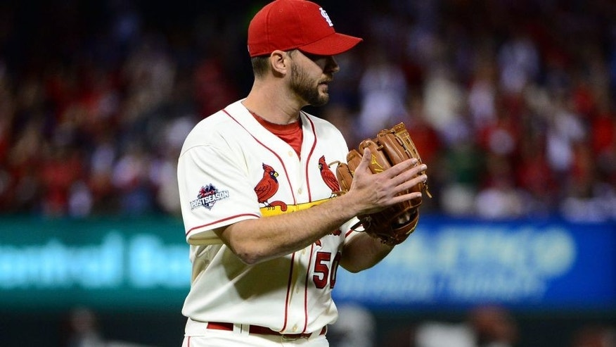 Oct 10, 2015; St. Louis, MO, USA; St. Louis Cardinals pitcher Adam Wainwright (50) reacts after ending the seventh inning in game two of the NLDS against the Chicago Cubs at Busch Stadium. Mandatory Credit: Jeff Curry-USA TODAY Sports