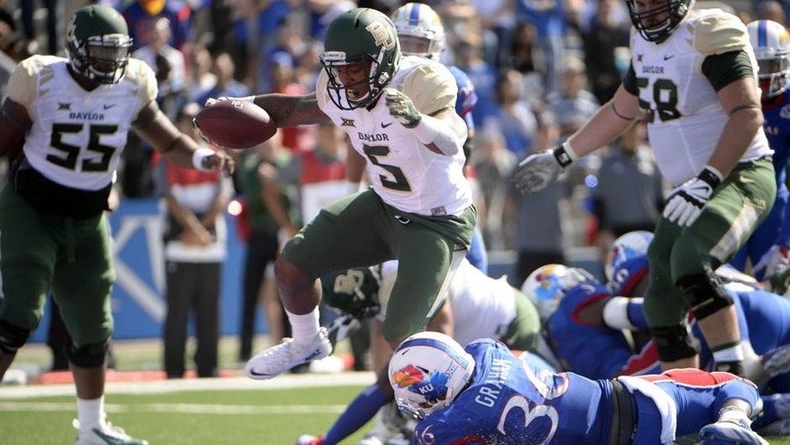 Oct 10, 2015; Lawrence, KS, USA; Baylor Bears running back Johnny Jefferson (5) rushes for a touchdown against Kansas Jayhawks cornerback Chevy Graham (36) in the first half at Memorial Stadium. Mandatory Credit: John Rieger-USA TODAY Sports