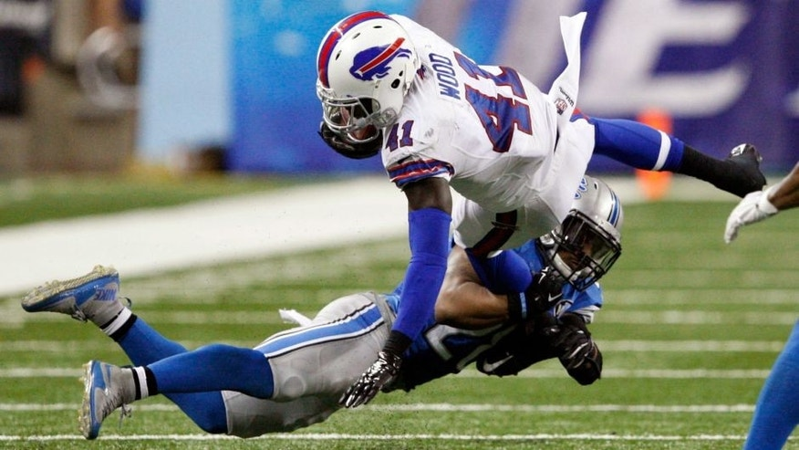 Sep 3, 2015; Detroit, MI, USA; Buffalo Bills running back Cierre Wood (41) gets tackled by Detroit Lions cornerback Quandre Diggs (28) during the fourth quarter of a preseason NFL football game at Ford Field. Lions beat the Bills 17-10. Mandatory Credit: Raj Mehta-USA TODAY Sports