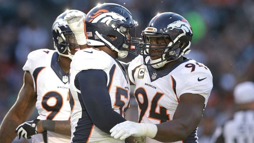 OAKLAND, CA - NOVEMBER 09: DeMarcus Ware #94 of the Denver Broncos celebrates with teammate Von Miller #58 in the third quarter against the Oakland Raiders at O.co Coliseum on November 9, 2014 in Oakland, California. (Photo by Ezra Shaw/Getty Images)