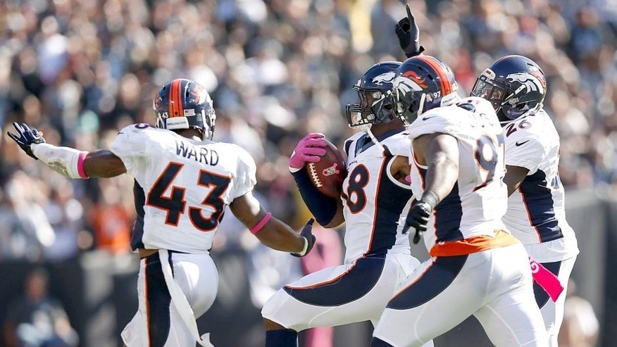 OAKLAND, CA - OCTOBER 11: Von Miller #58 of the Denver Broncos celebrates in the third quarter with teammates T.J. Ward #43 of the Denver Broncos, Malik Jackson #97 of the Denver Broncos and Darian Stewart #26 of the Denver Broncos against the Oakland Raiders at O.co Coliseum on October 11, 2015 in Oakland, California. (Photo by Ezra Shaw/Getty Images)