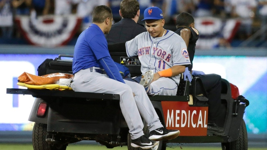 Oct. 10, 2015: New York Mets shortstop Ruben Tejada is taken off the field after being hurt in a double play against the Los Angeles Dodgers during the seventh inning in Game 2 of baseball's National League Division Series.