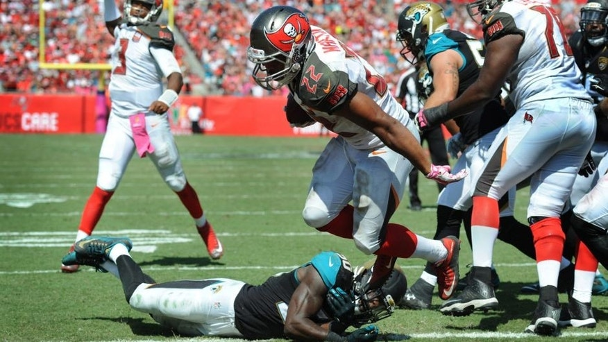 TAMPA, FL - OCTOBER 11: Running back Doug Martin #22 of the Tampa Bay Buccaneers scores a touchdown against the Jacksonville Jaguars in the second quarter at Raymond James Stadium on October 11, 2015 in Tampa, Florida. (Photo by Cliff McBride/Getty Images)