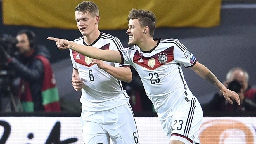 LEIPZIG, GERMANY - OCTOBER 11: Max Kruse of Germany (23) celebrates with team mate Matthias Ginter as he scores their second goal during the UEFA EURO 2016 Group D qualifying match between Germany and Georgia at Stadium Leipzig on October 11, 2015 in Leipzig, Germany. (Photo by Dennis Grombkowski/Bongarts/Getty Images)