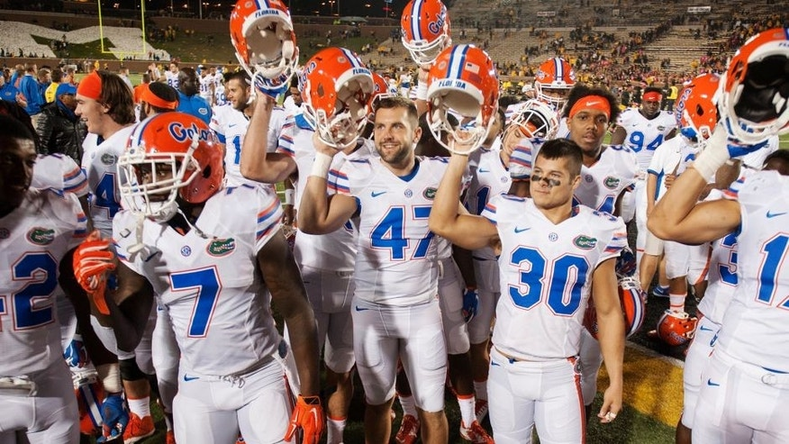 Florida teammates celebrate with their fans after they beat Missouri 21-3 in an NCAA college football game, Saturday, Oct. 10 2015, in Columbia, Mo. (AP Photo/L.G. Patterson)