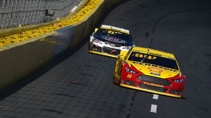 CHARLOTTE, NC - OCTOBER 11: Joey Logano, driver of the #22 Shell Pennzoil Ford, leads Kevin Harvick, driver of the #4 Jimmy John's/Budweiser Chevrolet, during the NASCAR Sprint Cup Series Bank of America 500 at Charlotte Motor Speedway on October 11, 2015 in Charlotte, North Carolina. (Photo by Robert Laberge/NASCAR via Getty Images)