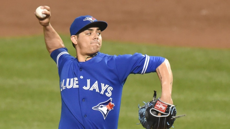 BALTIMORE, MD - SEPTEMBER 28:  Roberto Osuna #54 of the Toronto Blue Jays pitches in the ninth inning for his 20th save during a baseball game against the Baltimore Orioles at Oriole Park at Camden Yards on September 28, 2015 in Baltimore, Maryland.  The Blue Jays won 4-3.  (Photo by Mitchell Layton/Getty Images)