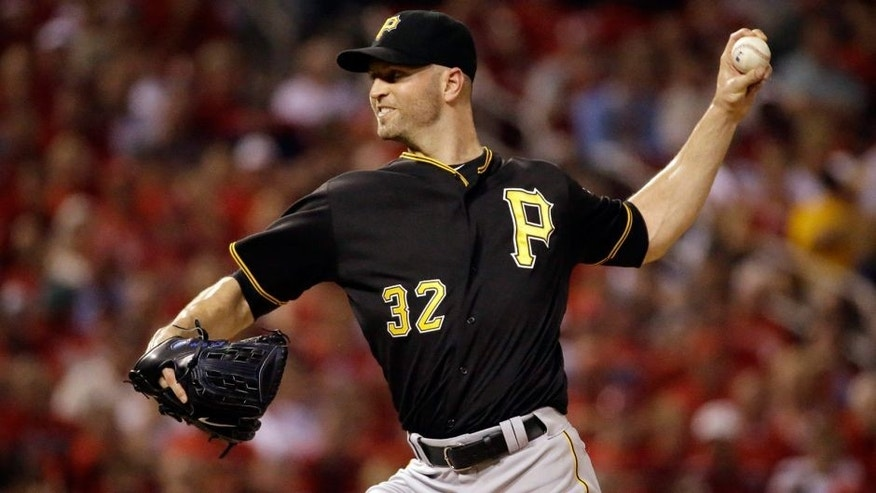 Pittsburgh Pirates starting pitcher J.A. Happ throws during the first inning of a baseball game against the St. Louis Cardinals on Friday, Sept. 4, 2015, in St. Louis. (AP Photo/Jeff Roberson)