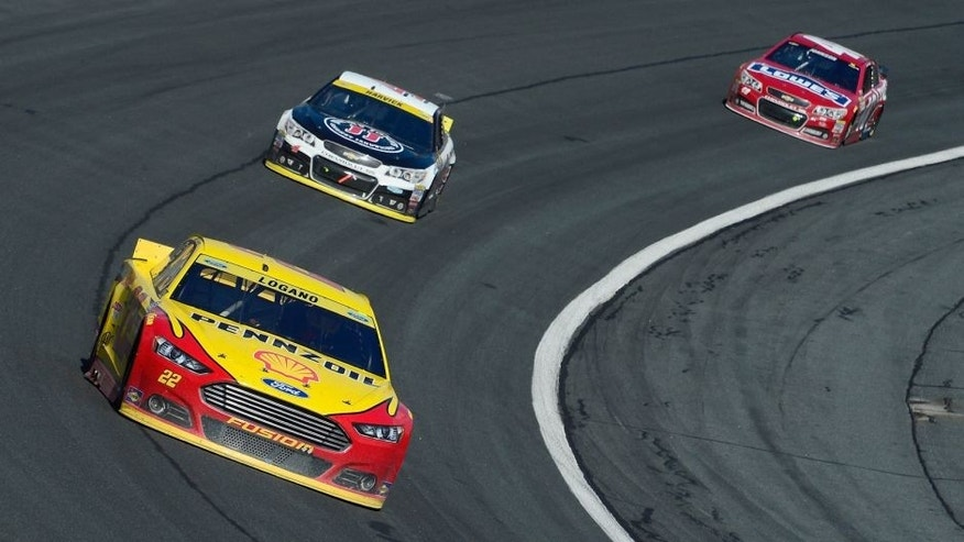 CHARLOTTE, NC - OCTOBER 11: Joey Logano, driver of the #22 Shell Pennzoil Ford, leads a pack of cars during the NASCAR Sprint Cup Series Bank of America 500 at Charlotte Motor Speedway on October 11, 2015 in Charlotte, North Carolina. (Photo by Robert Laberge/NASCAR via Getty Images)