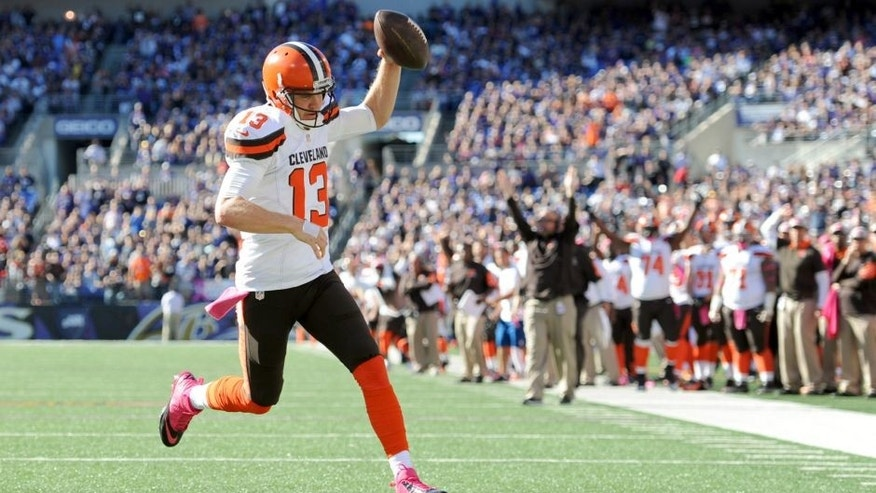 Cleveland Browns quarterback Josh McCown scores a touchdown in the second half of an NFL football game against the Baltimore Ravens, Sunday, Oct. 11, 2015, in Baltimore. (AP Photo/Gail Burton)