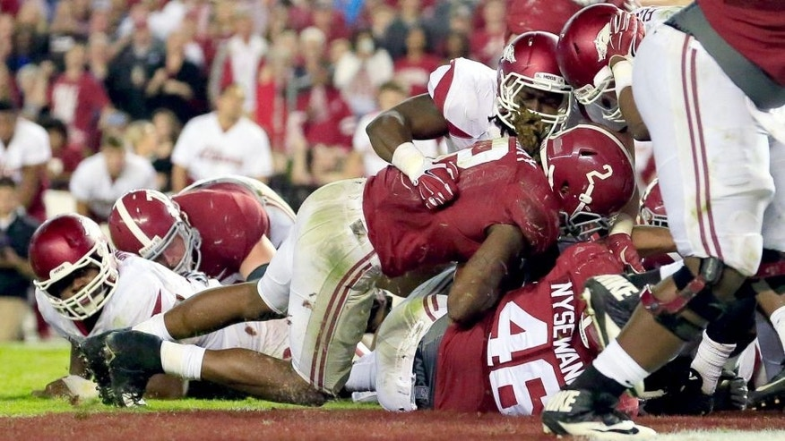 Oct 10, 2015; Tuscaloosa, AL, USA; Alabama Crimson Tide running back Derrick Henry (2) scores a touchdown during the fourth quarter against Arkansas Razorbacks at Bryant-Denny Stadium. Alabama defeated Arkansas 27-14. Mandatory Credit: Marvin Gentry-USA TODAY Sports