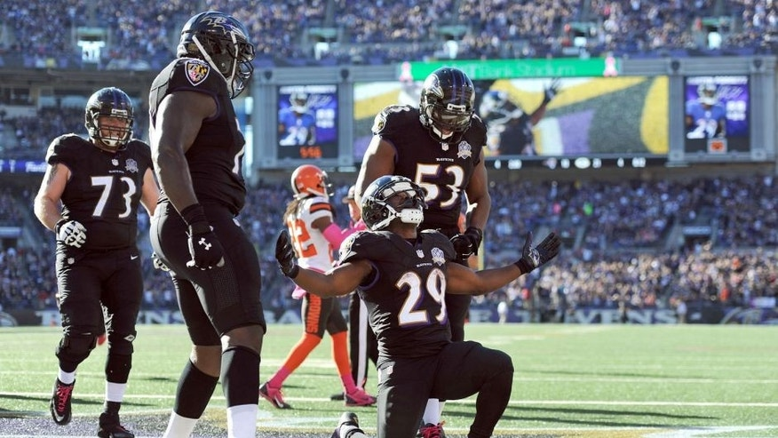 Baltimore Ravens running back Justin Forsett (29) celebrates his touchdown with teammates in the second half of an NFL football game against the Cleveland Browns, Sunday, Oct. 11, 2015, in Baltimore. (AP Photo/Gail Burton)