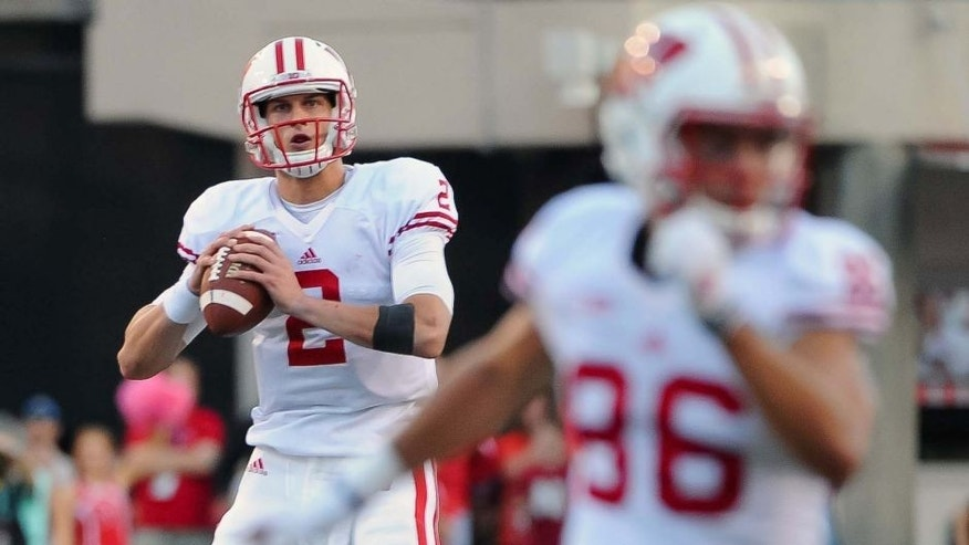 Wisconsin Badgers quarterback Joel Stave rolls out on the final drive of the game against the Nebraska Cornhuskers at Memorial Stadium in Lincoln, Neb., on Saturday, Oct. 10, 2015. Wisconsin won 23-21.