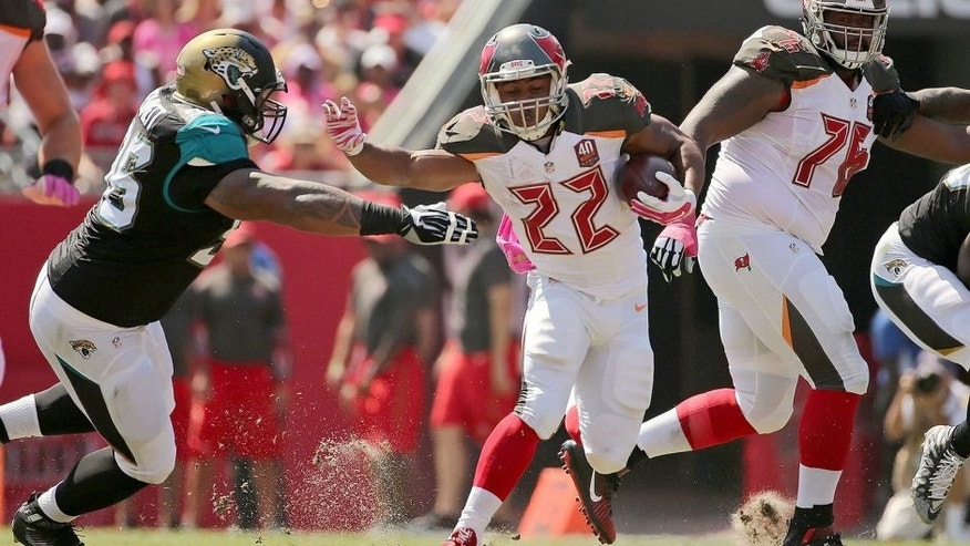 TAMPA, FL - OCTOBER 11: Doug Martin #22 of the Tampa Bay Buccaneers rushes during a game against the Jacksonville Jaguars at Raymond James Stadium on October 11, 2015 in Tampa, Florida. (Photo by Mike Ehrmann/Getty Images)