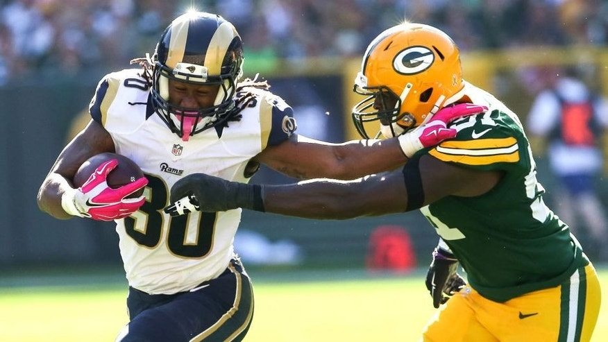 GREEN BAY, WI - OCTOBER 11: Todd Gurley #30 of the St. Louis Rams carries the football against Nate Palmer #51 of the Green Bay Packers in the third quarter at Lambeau Field on October 11, 2015 in Green Bay, Wisconsin. (Photo by Jonathan Daniel/Getty Images)