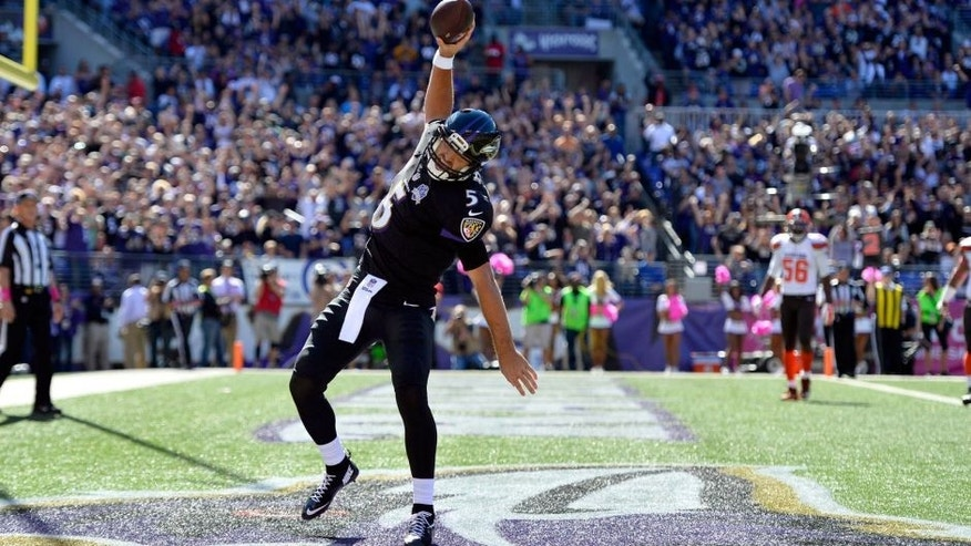 Oct 11, 2015; Baltimore, MD, USA; Baltimore Ravens quarterback Joe Flacco (5) celebrates after scoring a running touchdown during the first quarter against the Cleveland Browns at M&T Bank Stadium. Mandatory Credit: Tommy Gilligan-USA TODAY Sports