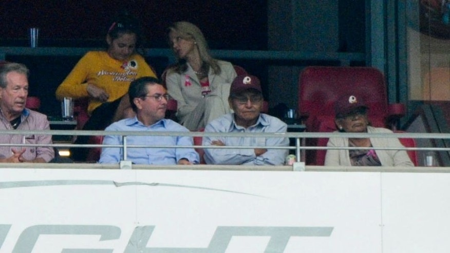 Oct 12, 2014; Glendale, AZ, USA; Washington Redskins owner Dan Snyder (left) talks with Navajo Nation president Ben Shelly (right) during the first half against the Arizona Cardinals at University of Phoenix Stadium. Mandatory Credit: Matt Kartozian-USA TODAY Sports