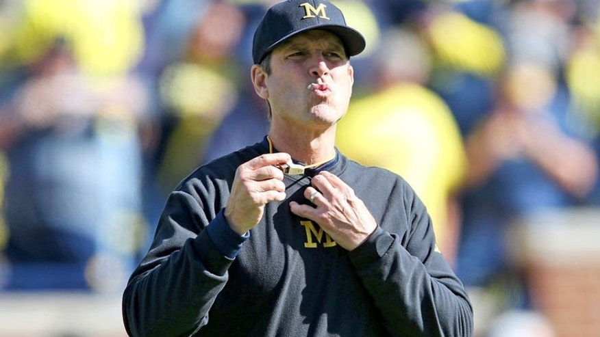 ANN ARBOR MI - OCTOBER 10: Michigan Wolverines head football coach Jim Harbaugh watches the pregame warms ups prior to the start of the game against the Northwestern Wildcats on October 10, 2015 at Michigan Stadium in Ann Arbor, Michigan. The Wolverines defeated the Wildcats 38-0. (Photo by Leon Halip/Getty Images)