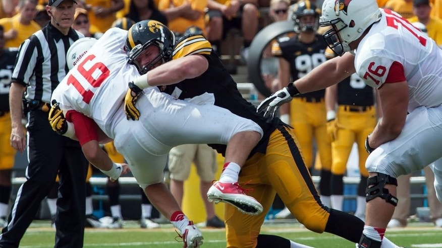 Sep 5, 2015; Iowa City, IA, USA; Iowa City, IA, USA; Iowa Hawkeyes defensive lineman Drew Ott (95) tackles Illinois State Redbirds quarterback Jake Kolbe (16) during the fourth quarter at Kinnick Stadium. Iowa won 31-14. Mandatory Credit: Jeffrey Becker-USA TODAY Sports