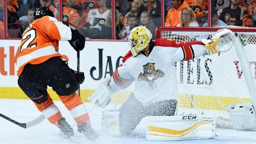 Oct 12, 2015; Philadelphia, PA, USA; Philadelphia Flyers left wing Michael Raffl (12) has his shot stopped by Florida Panthers goalie Roberto Luongo (1) during the second period at Wells Fargo Center. Mandatory Credit: Eric Hartline-USA TODAY Sports