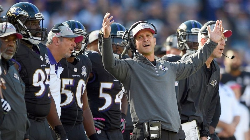 Baltimore Ravens head coach John Harbaugh reacts to a penalty call against Baltimore's defense in the second half of an NFL football game against the Cleveland Browns, Sunday, Oct. 11, 2015, in Baltimore. (AP Photo/Nick Wass)