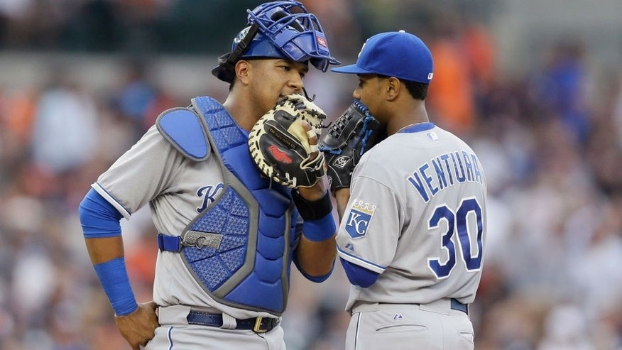 Kansas City Royals catcher Salvador Perez, left, talks with starting pitcher Yordano Ventura during the second inning of a baseball game against the Detroit Tigers, Friday, May 8, 2015, in Detroit. (AP Photo/Carlos Osorio)