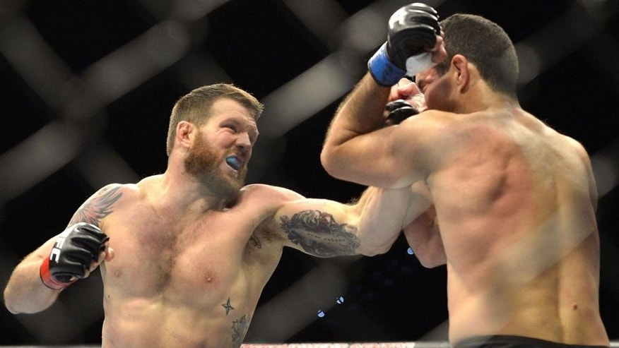 BRISBANE, AUSTRALIA - DECEMBER 07: Ryan Bader of the USA punches Anthony Perosh of Australia during their UFC Fight Night Brisbane bout at the Brisbane Entertainment Centre on December 7, 2013 in Brisbane, Australia. (Photo by Bradley Kanaris/Getty Images)