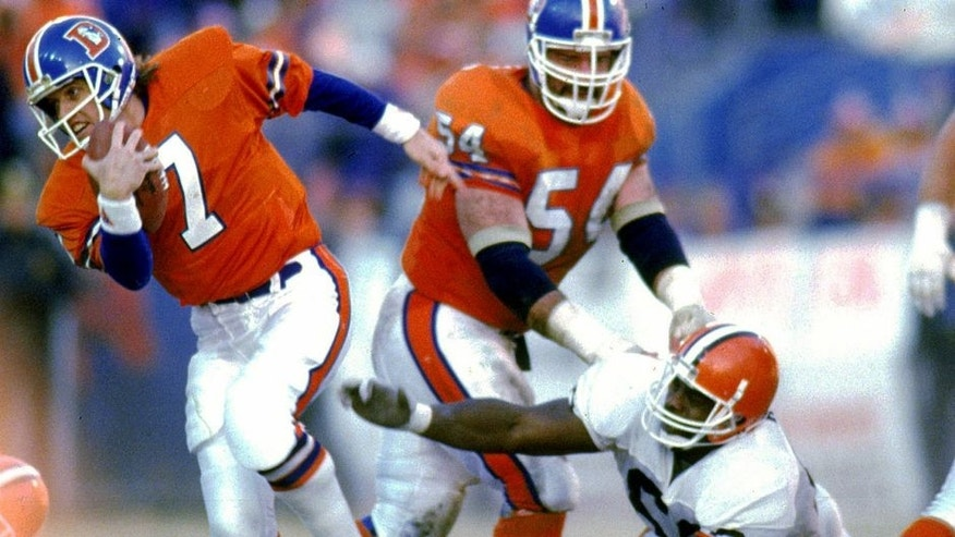 DENVER, CO - JANUARY 17: Quarterback John Elway #7 of the Denver Broncos runs upfield to elude the Cleveland Browns defense in the 1987 AFC Championship Game at Mile High Stadium on January 17, 1988 in Denver, Colorado. The Broncos defeated the Browns 38-33. (Photo by E.L. Bakke/Getty Images)