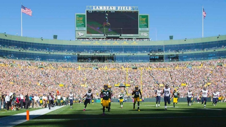 Green Bay Packers cornerback Quinten Rollins returns an interception for a touchdown in the first quarter against the St. Louis Rams at Lambeau Field in Green Bay, Wis., on Sunday, Oct. 11, 2015.