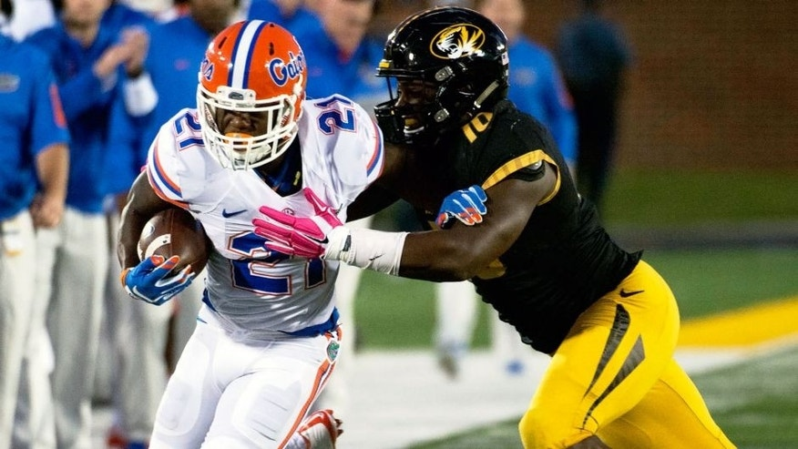 Florida running back Kelvin Taylor, left, is pushed out of bounds by Missouri's Kentrell Brothers during the first half of an NCAA college football game, Saturday, Oct. 10 2015, in Columbia, Mo. (AP Photo/L.G. Patterson)