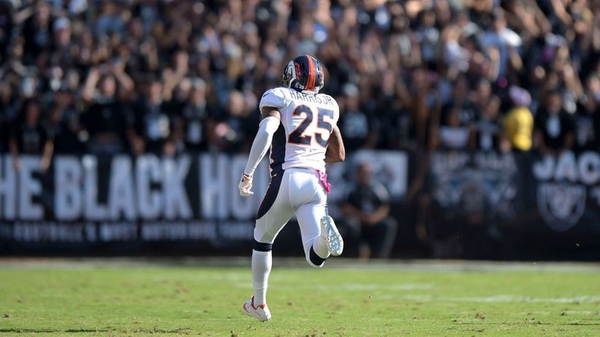Oct 11, 2015; Oakland, CA, USA; Denver Broncos cornerback Chris Harris Jr. (25) scores on a 75-yard interception return in the fourth quarter against the Oakland Raiders at O.co Coliseum. Mandatory Credit: Kirby Lee-USA TODAY Sports
